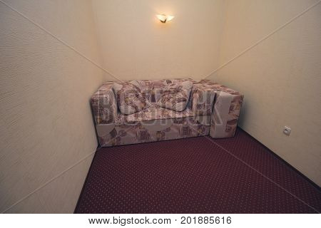 Sofa in the hallway of the hotel economy class. Interior