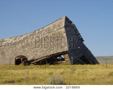 old collapsed barn in the middle of nowhere poster
