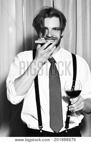 Happy Bearded Man Eating Pizza And Drinking Wine