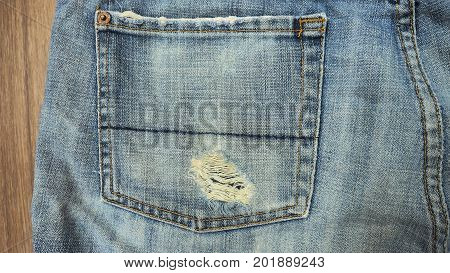 Jeans shorts close up at left bag has free space for your background.
