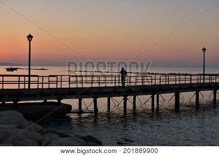 Pier, sunrise over the Mediterranean sea, beautiful dawn.