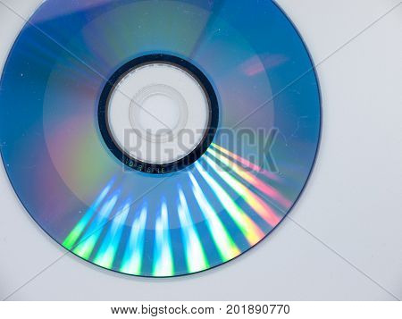 A single compact disk on a white background