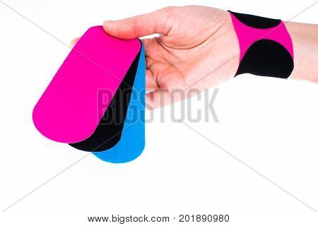 hand with kinesiology tape. Physiotherapy and therapeutic tape for wrist pain, aches and tension. elastic therapeutic tape. adhesive tape and alternative medicine.
