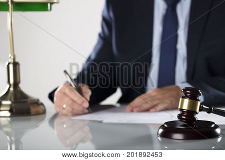 Lawyers office. Business concept. Man signing agreement.