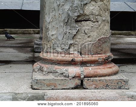 Column. Fragment of old crumbling columns. Architectural background. Column. Architecture.