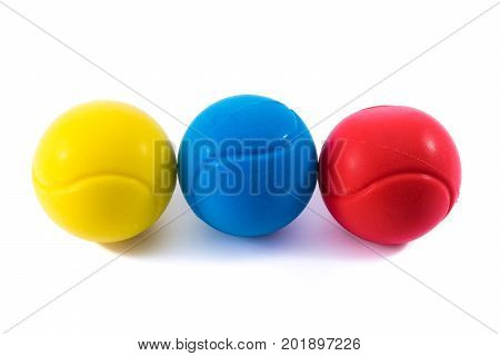 Yellow, blue and red stressballs.Physiotherapy and  alternative medicine.