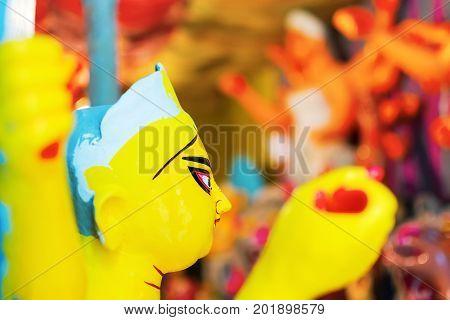 KOLKATA WEST BENGAL INDIA - 25 SEPTEMBER 2016: Clay idol of Goddess Durga under preparation for