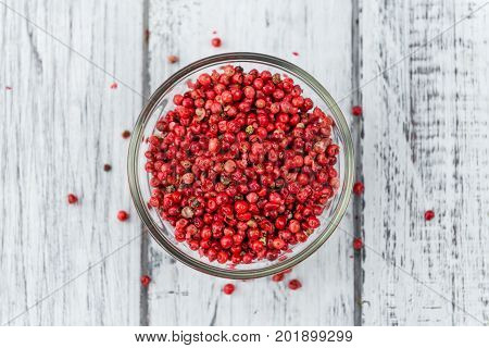 Portion Of Pink Peppercorns On Wooden Background, Selective Focus