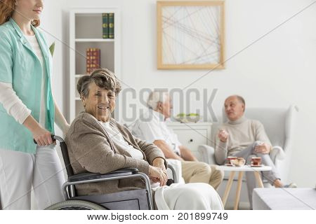 Nurse Helps Happy Senior