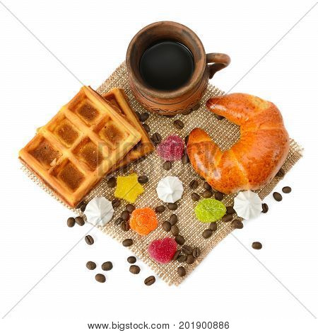 Cup of coffee croissant waffles and marmalade isolated on white background.