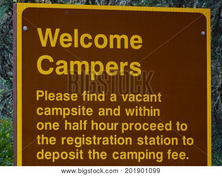 A Campers Welcome Sign with Registration Rules.