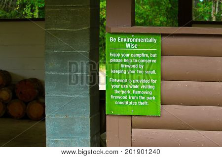 A Be Environmentally Wise About Firewood Sign