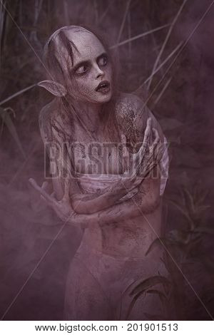 Portrait Of A Horrible Scary Fantasy Style Mystic Creature. Horror Or Halloween Concept.