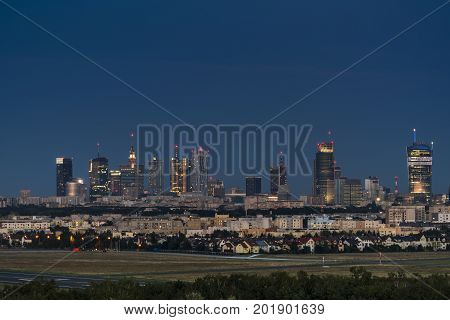 Warsaw city downtown panorama during the night Poland