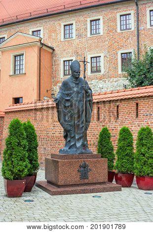 Krakow/Poland- August 14, 2017: Wawel Royal Castle, monument of Pope Saint John Paul II near Catholic Cathedral