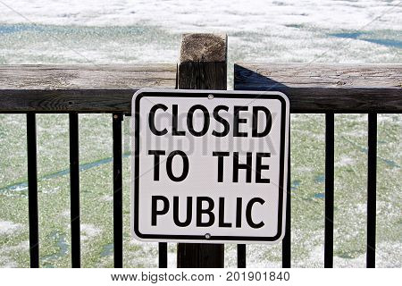 Closed To The Public Sign Posted On A Water Boardwalk