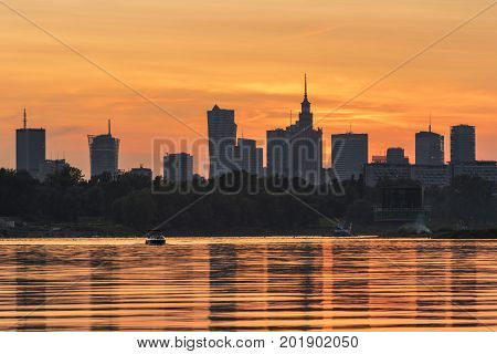 Sunset over Warsaw city during summer time Poland