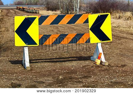 Detour Construction Barricade Along A Gravel Road