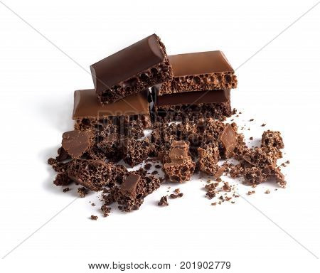 A slice of porous chocolate slices on a white background