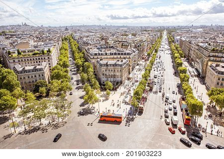Aerial wide angle cityscape view on the beautiful buildings and avenues near the Triumphal arch during the sunny day in Paris