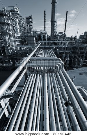 oil, gas and fule industrial installation, dark duplex blue toning idea.