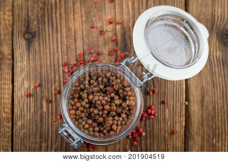 Portion Of Pink Peppercorns (preserved) On Wooden Background, Selective Focus