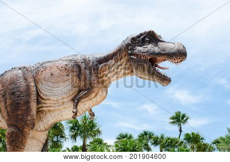 PATTAYA THAILAND - AUGUST 13 2017 : Tyrannosaurus is a genus of coelurosaurian theropod dinosaur. The species Tyrannosaurus rex is one of the most well-represented of the large theropods.