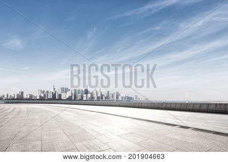 cityscape of hangzhou in blue cloud sky from emtpy marble floor