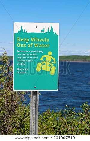 Keep Wheels Out Of Water Sign Along A Lakeshore