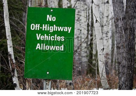 A No Off Highway Vehicles Allowed sign.