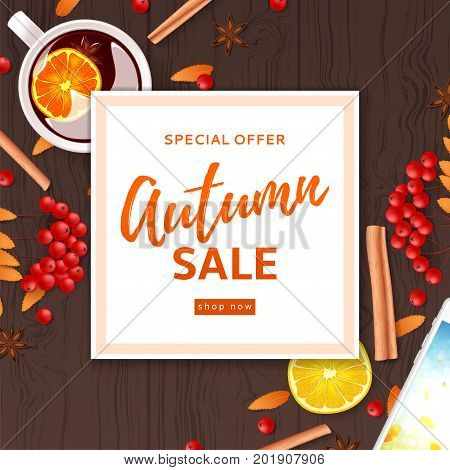 Autumn sale background divided on layers. Top view on composition with cup of mulled wine, rowan, cinnamon sticks on wooden texture. Vector illustration for shopping sale.