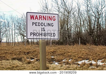 A warning peddling is prohibited sign in winter