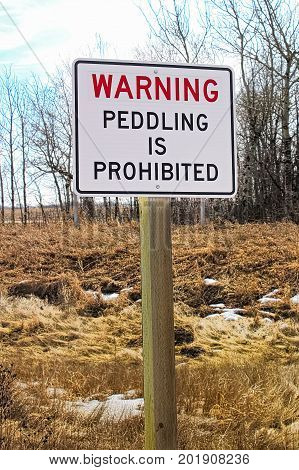A warning peddling is prohibited sign in winter.
