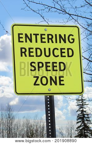 Entering a reduced speed zone area sign