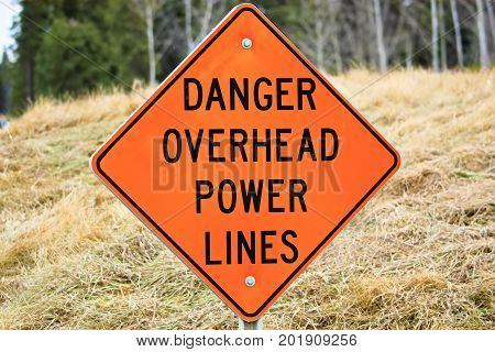Closeup Of A Danger Overhead Power Line Sign