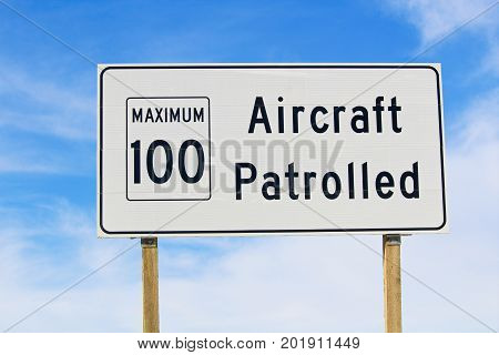 Closeup Of An Aircraft Patrolled Sign With Maximum Speed Limit
