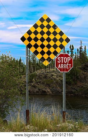 A Checkered No Entry And Stop Sign In Both English And French