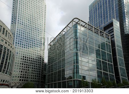 Looking up at High rise glass buildings in Canary Wharf. Canary Wharf is one of the largest financial districts in London and has some of the tallest buildings in Europe. London England 2017