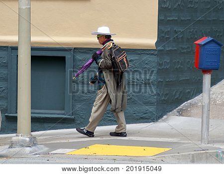 San Francisco, California - April 13, 2017: A man in white hat on the street in San Francisco, California.