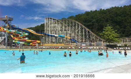 Queensbury. New York - August 2017: Families enjoying summer fun in the amusement park in Queensbury, New York