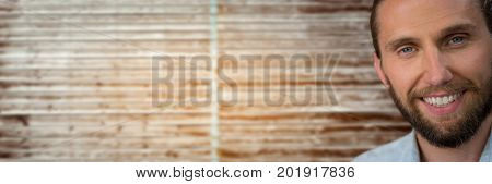 Digital composite of Portraiture of bearded man against blurry wood panel