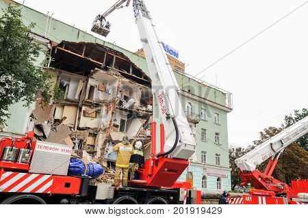 Orel Russia August 29 2017: Collapse of old apartment house. Elevating cranes on fire trucks and EMERCOM rescue team works on ruined building horizontal