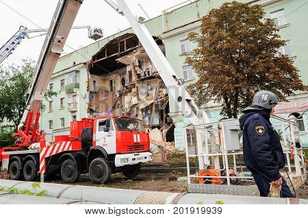 Orel Russia August 29 2017: Collapse of old apartment house. Fire truck and elevating crane of EMERCOM working at ruined building horizontal