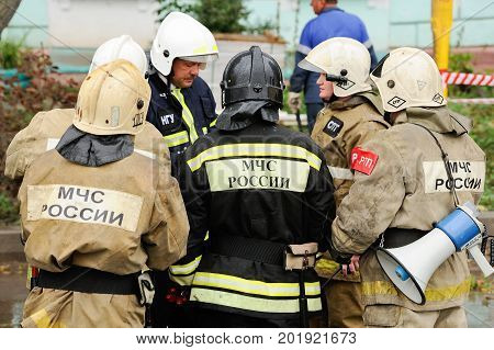 Orel Russia August 29 2017: Collapse of old apartment house. EMERCOM rescue team in uniforms and helmets closeup