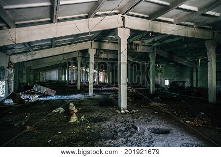 Abandoned warehouse building interior, dark abandoned industrial building, toned