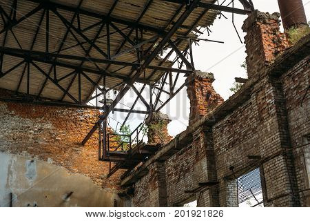 Interior of red brick abandoned warehouse or factory