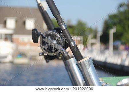 Two fishing poles on a boat on the Great Lakes
