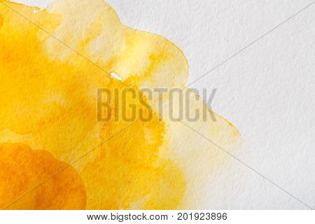 Abstract watercolor yellow spot painted texture background.