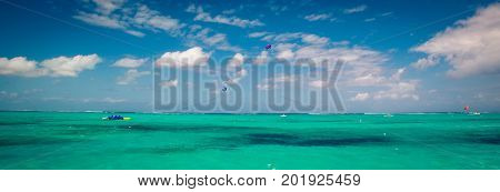 Paragliders and the Caribbean sea Turks and caicos poster