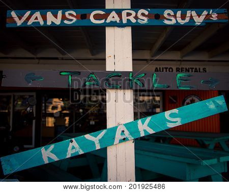 A car and kayak rental sign on Turks and Caicos island poster